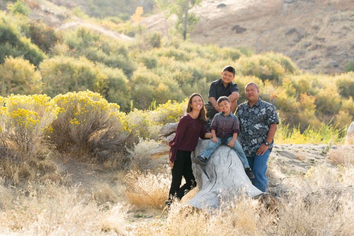 Family of four on a log at Mayberry Park in the Fall by Reno Family Photographer