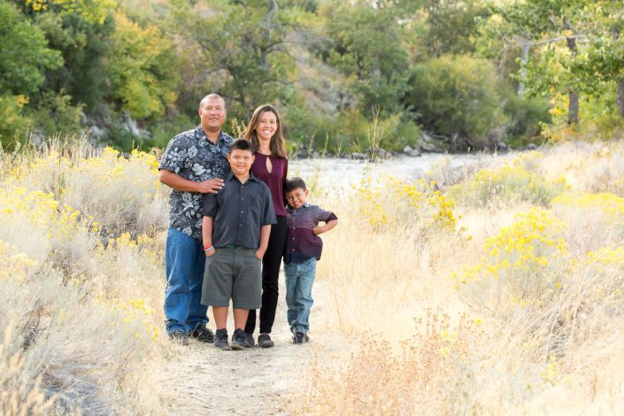 Family of four from Hawaii stands in dirt path at Mayberry Park for Reno Family Portraits by Reno Family Photographer