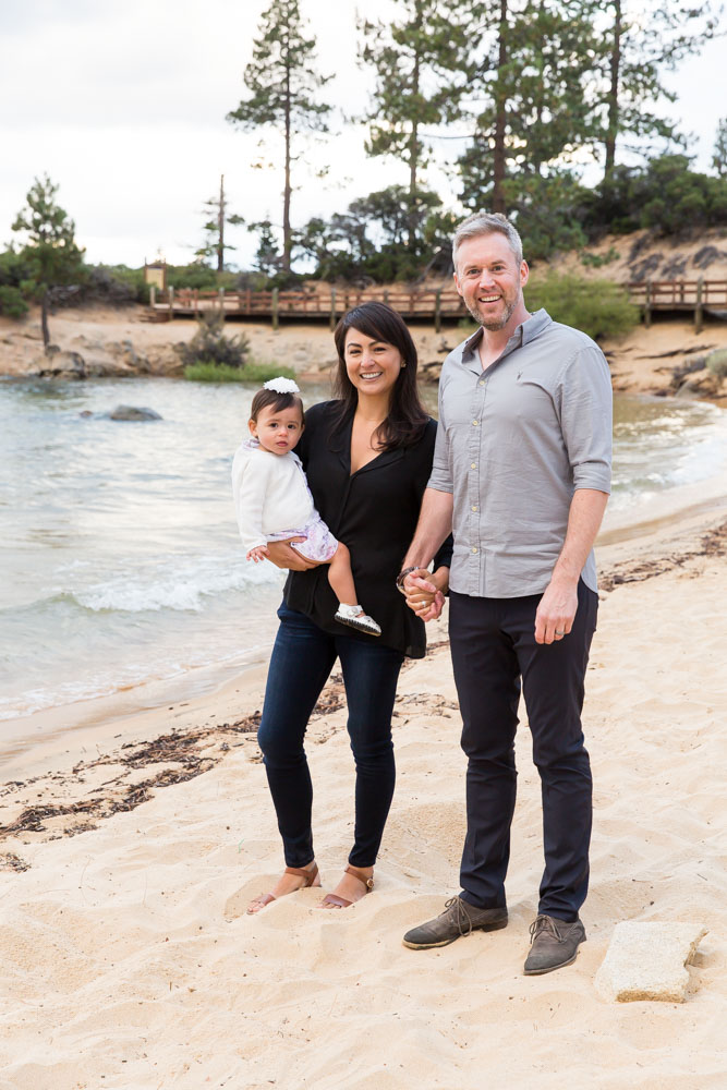 Family portrait at Sand Harbor of family standing on beach by Lake Tahoe Family Photographer