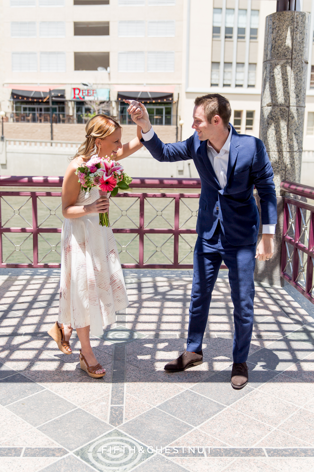 Bride and groom celebrate as they are announced man and wife at a Downtown Reno elopement by Reno Wedding Photographer