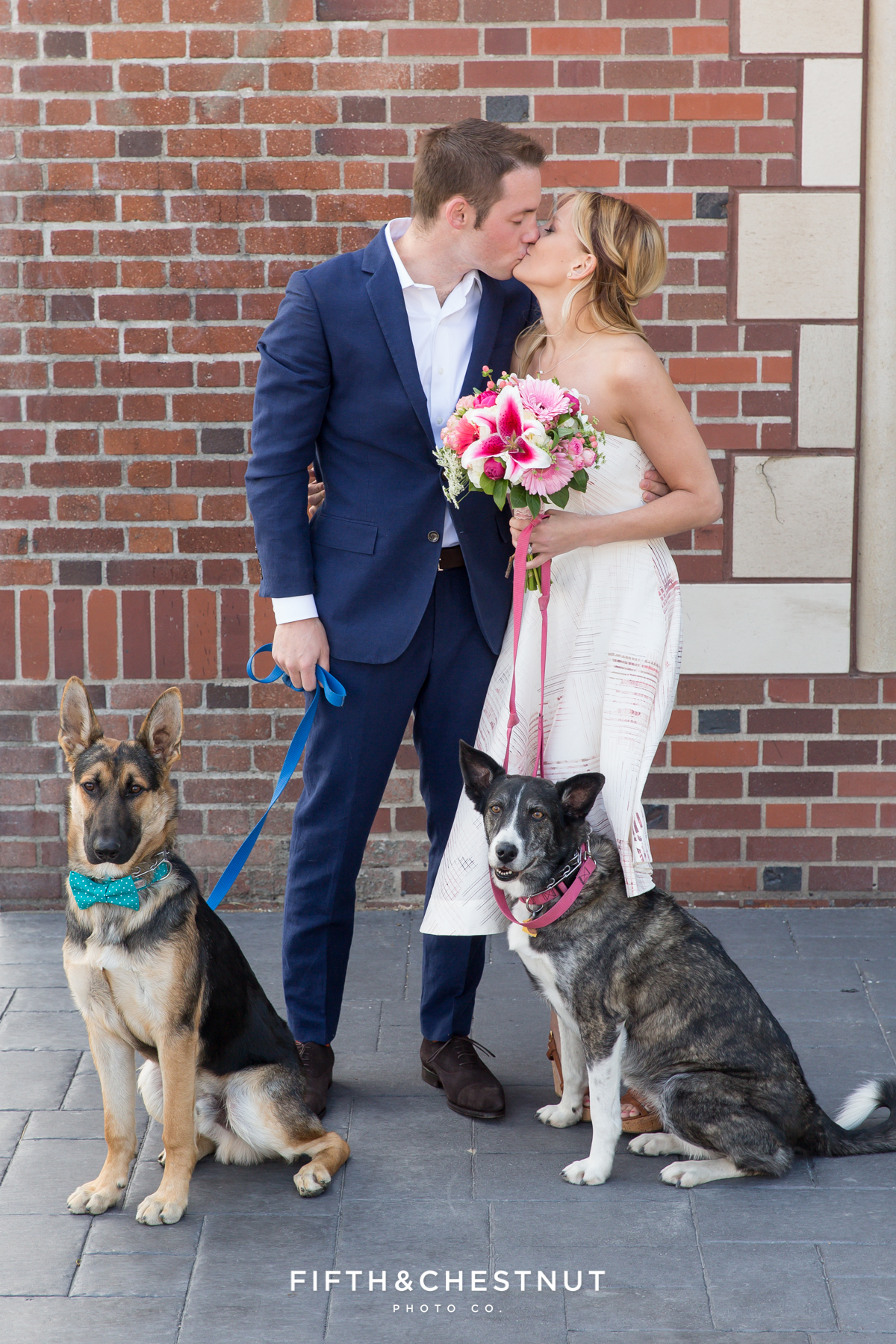 Bride and groom kissing for their Downtown Reno elopement by Reno Wedding Photographer