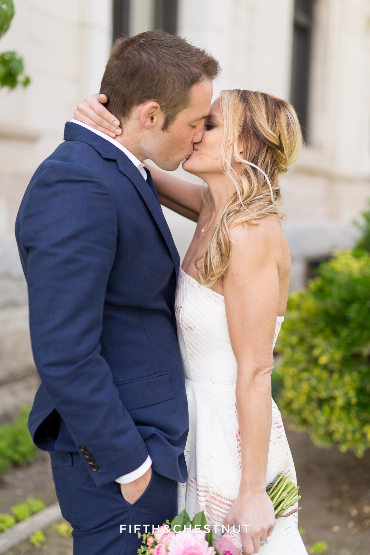 Bride and groom share a kiss during their Downtown Reno elopement by Reno Wedding Photographer
