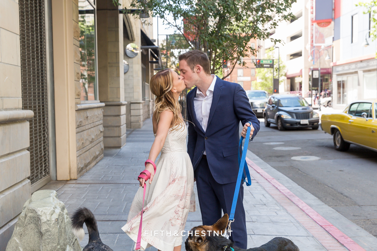 Wedding couple walking dogs during a Downtown Reno elopement by Reno Wedding Photographer