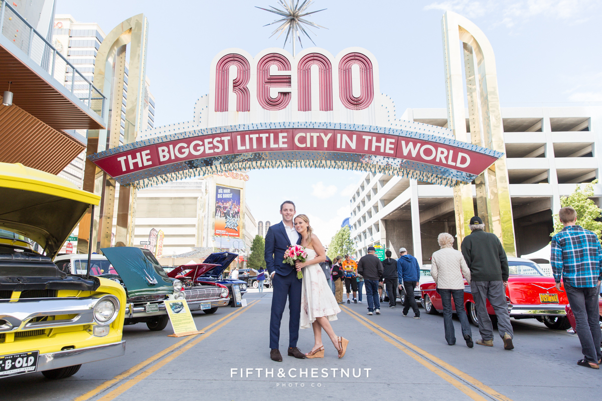 Bride and groom under the Reno Arch for a Downtown Reno elopement by Reno Wedding Photographer