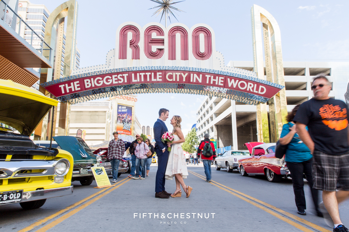 Bride and groom under the reno arch during their downtown Reno Elopement