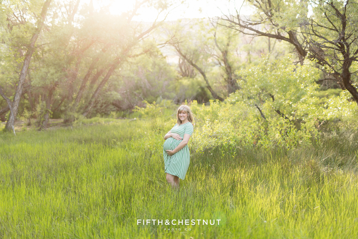 gorgeous pregnant woman in a large open field for her maternity photography in reno