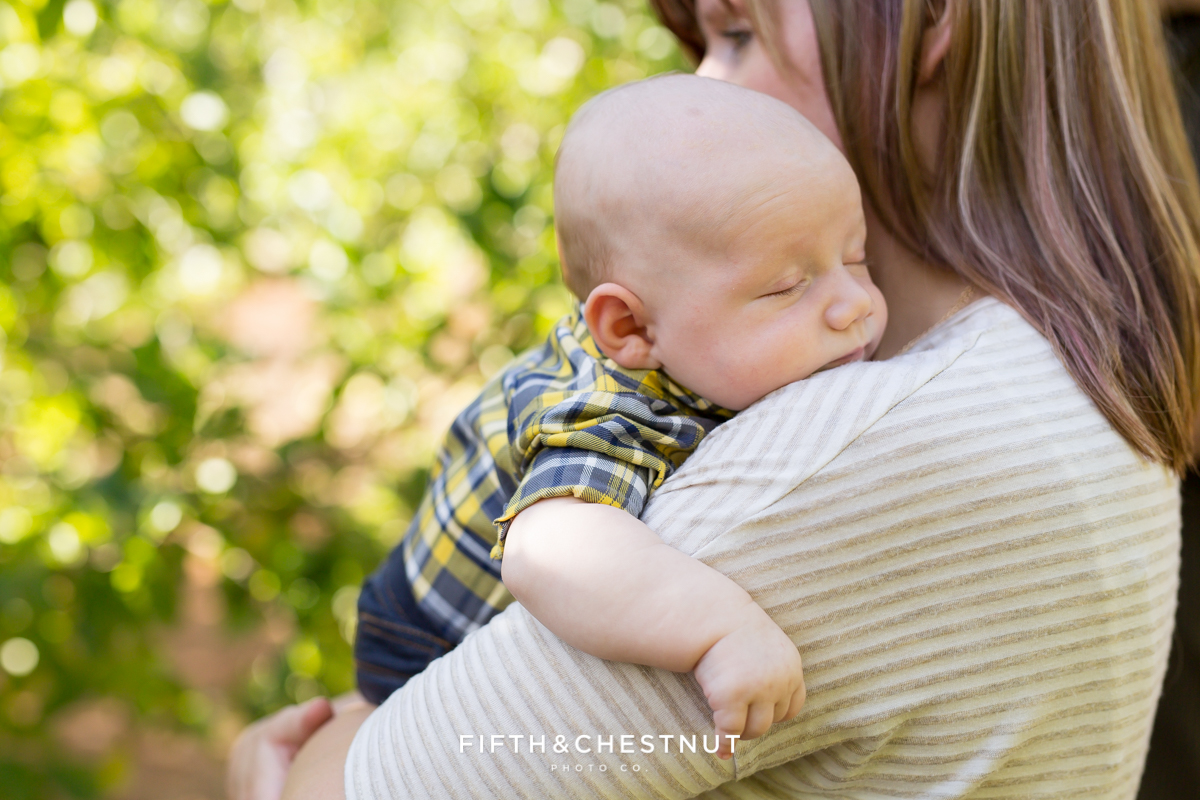 Apple Hill Portrait 3 month old baby sleeping on mother's shoulder by Reno Family Photographer
