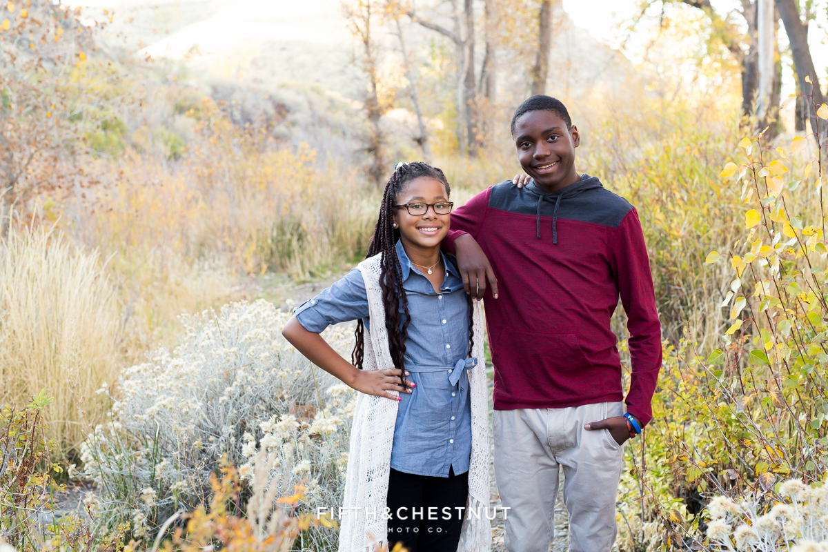 Cute fall family portrait of siblings at Mayberry Park in Reno by Reno Family Photographer