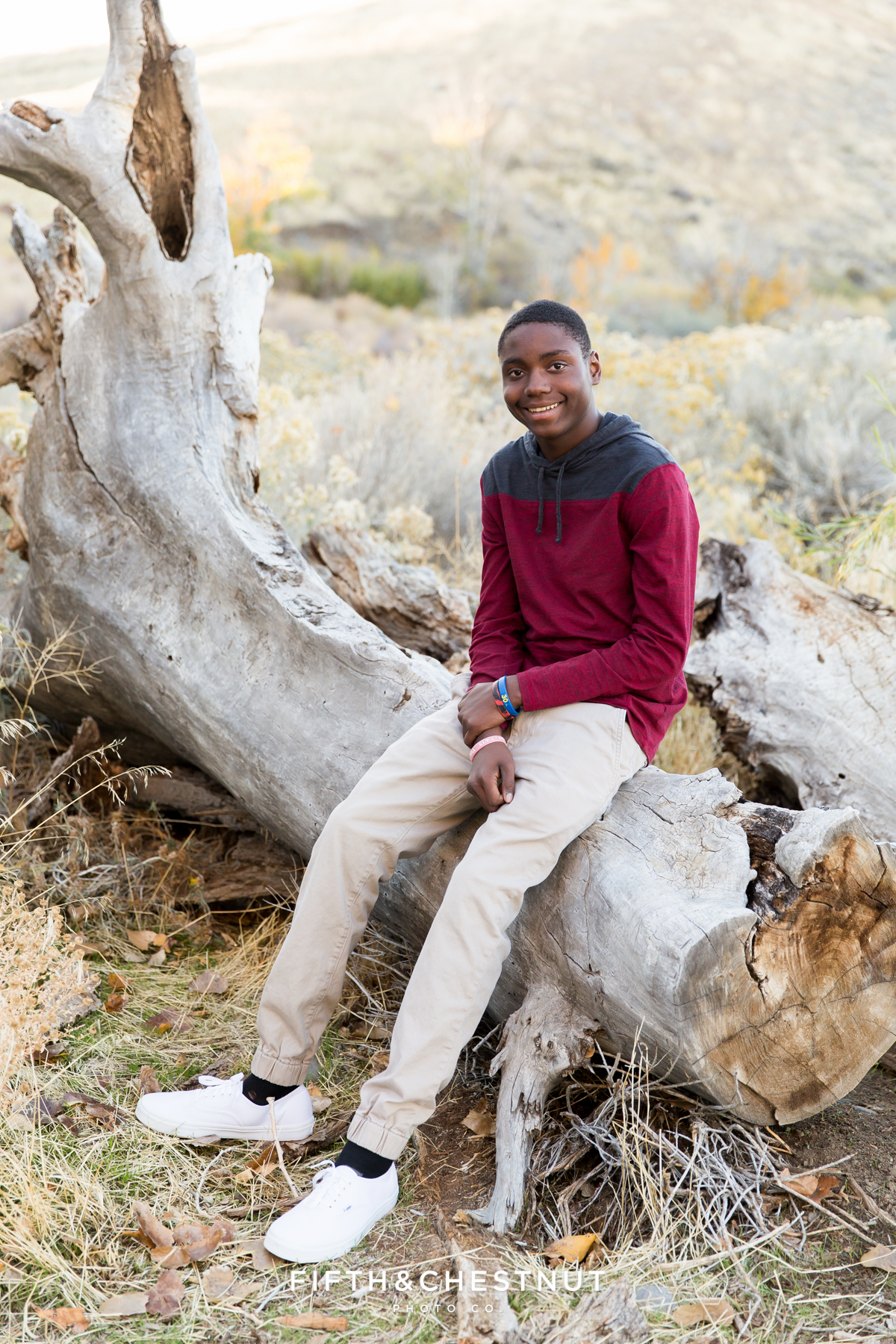 Fall family portraits of a young man at Mayberry Park in Reno by Reno Family Photographer