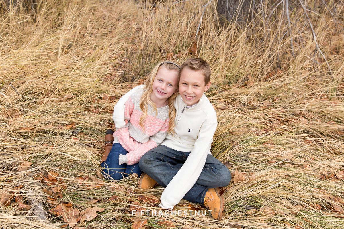 Brother and sister pose for Holiday Reno Family Portraits in Verdi by Reno Family Photographer