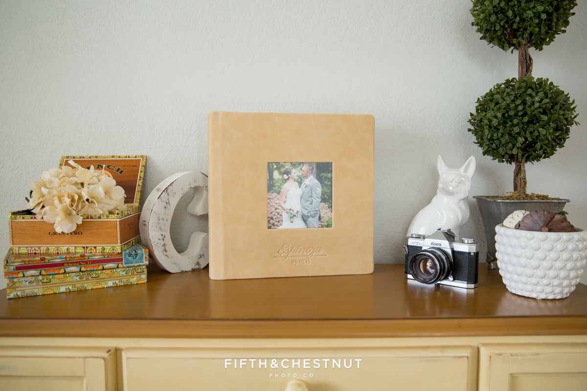 A leather wedding album sitting on a table