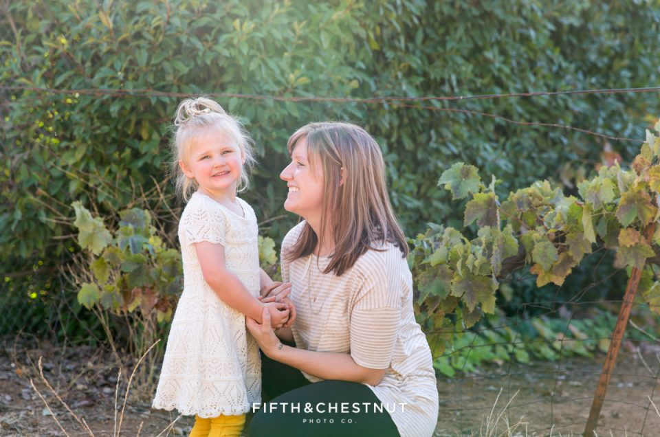 Portrait of Mom and daughter in an apple orchard by Reno Family Photographer