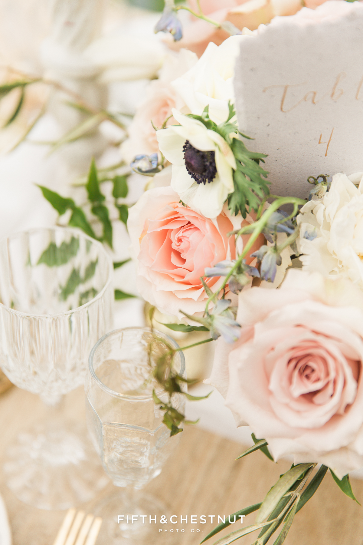 Up close detail of beautiful garden roses and anenome flowers in a Dusty Blue Private Estate Country French Wedding Styled Shoot centerpiece