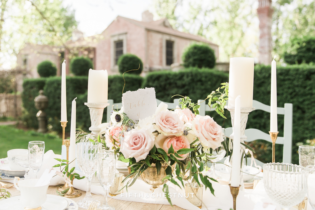 Country French wedding centerpiece in front of a brick and stone private estate in Reno, NV