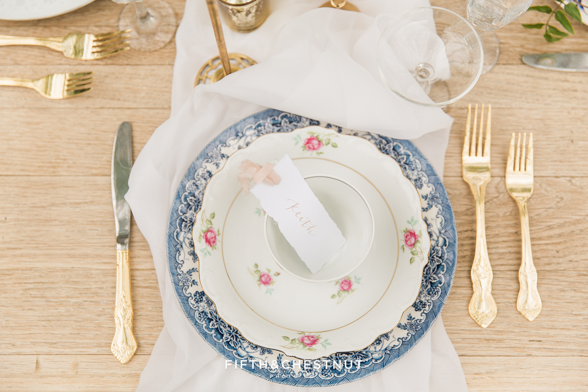 escort cards and plate details at a Dusty Blue Private Estate Country French Wedding Styled Shoot