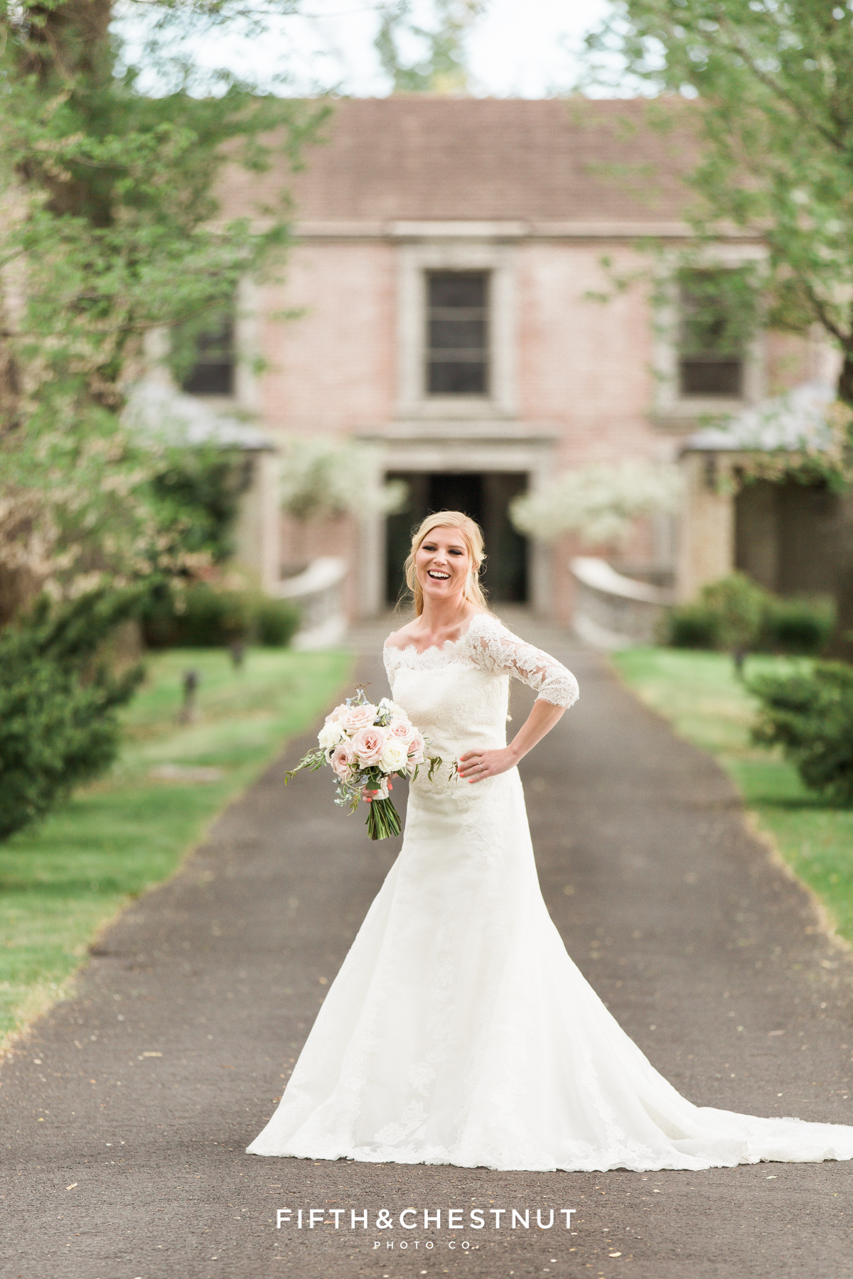 Happy bride laughing at a dusty blue country french wedding styled shoot at Reno private estate