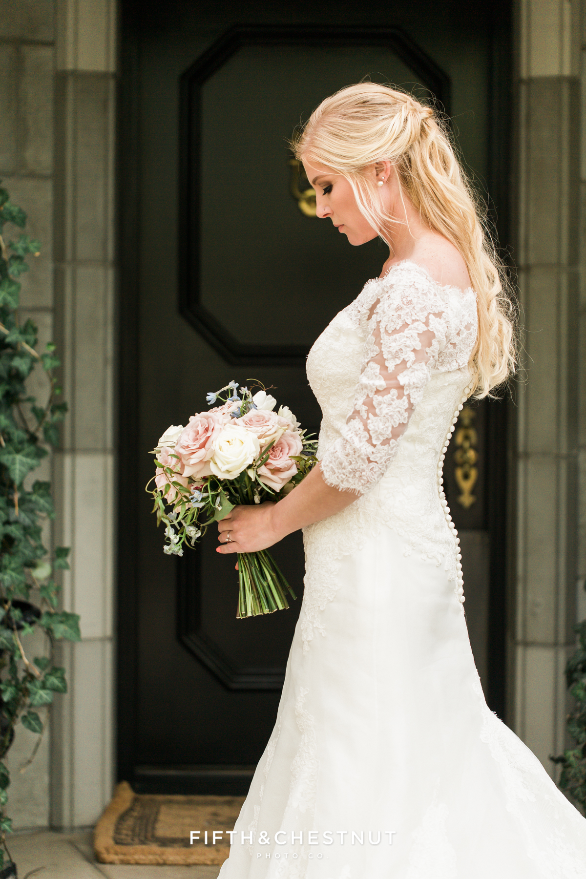 Bride standing in front of a black door at a private estate for a Country French Wedding Styled Shoot in Reno