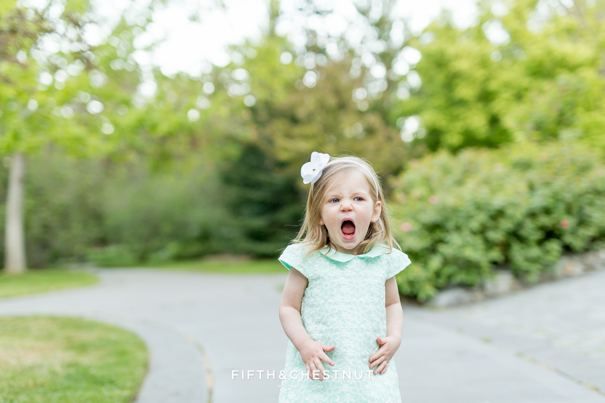 Toddler makes a funny and silly face at a Reno maternity portrait session by Reno Maternity photographer