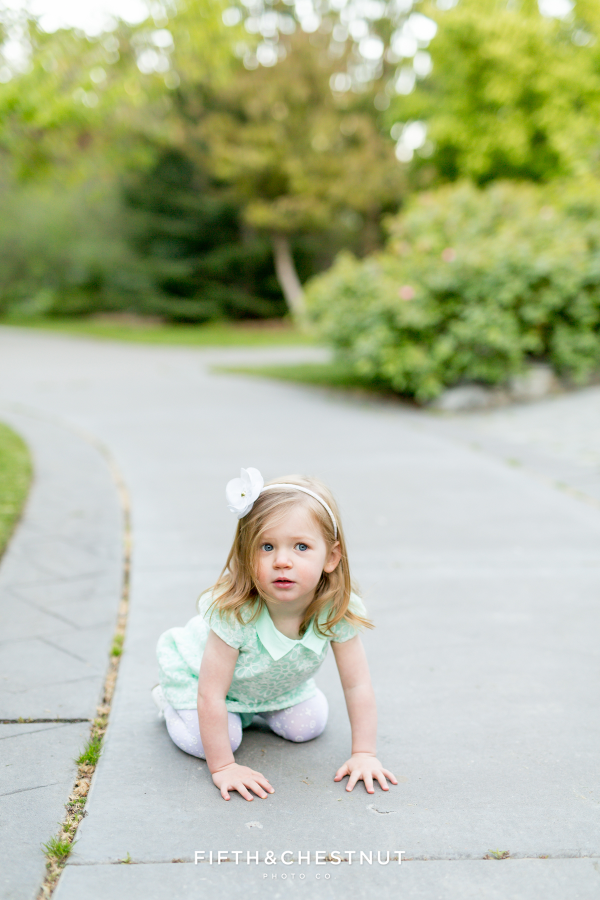 two year old girl pretending to be a frog at Rancho san rafael for reno maternity portraits