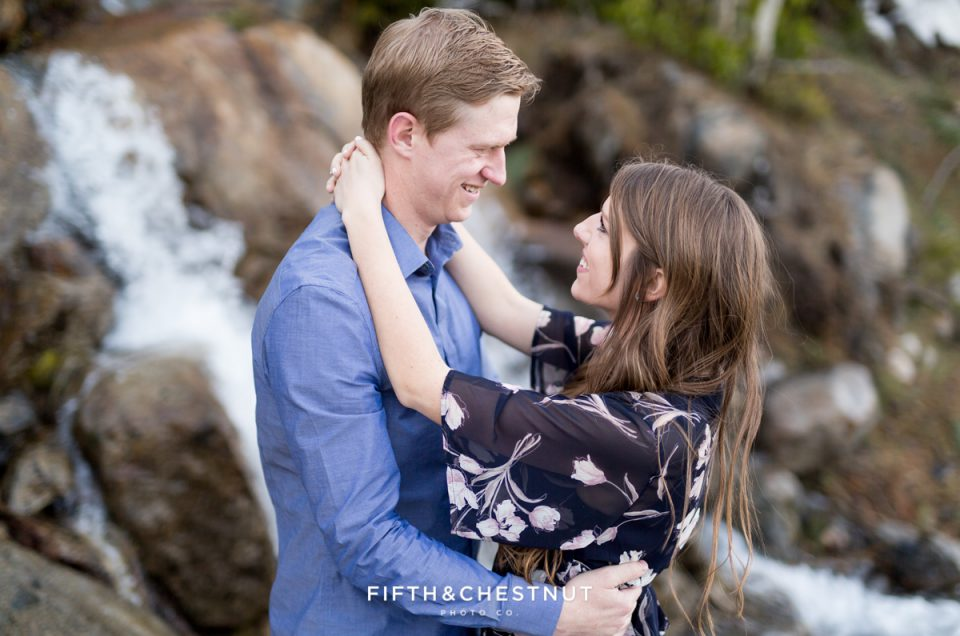 Windy Donner Lake Engagement Portrait of bride an groom to be by Lake Tahoe Wedding Photographer