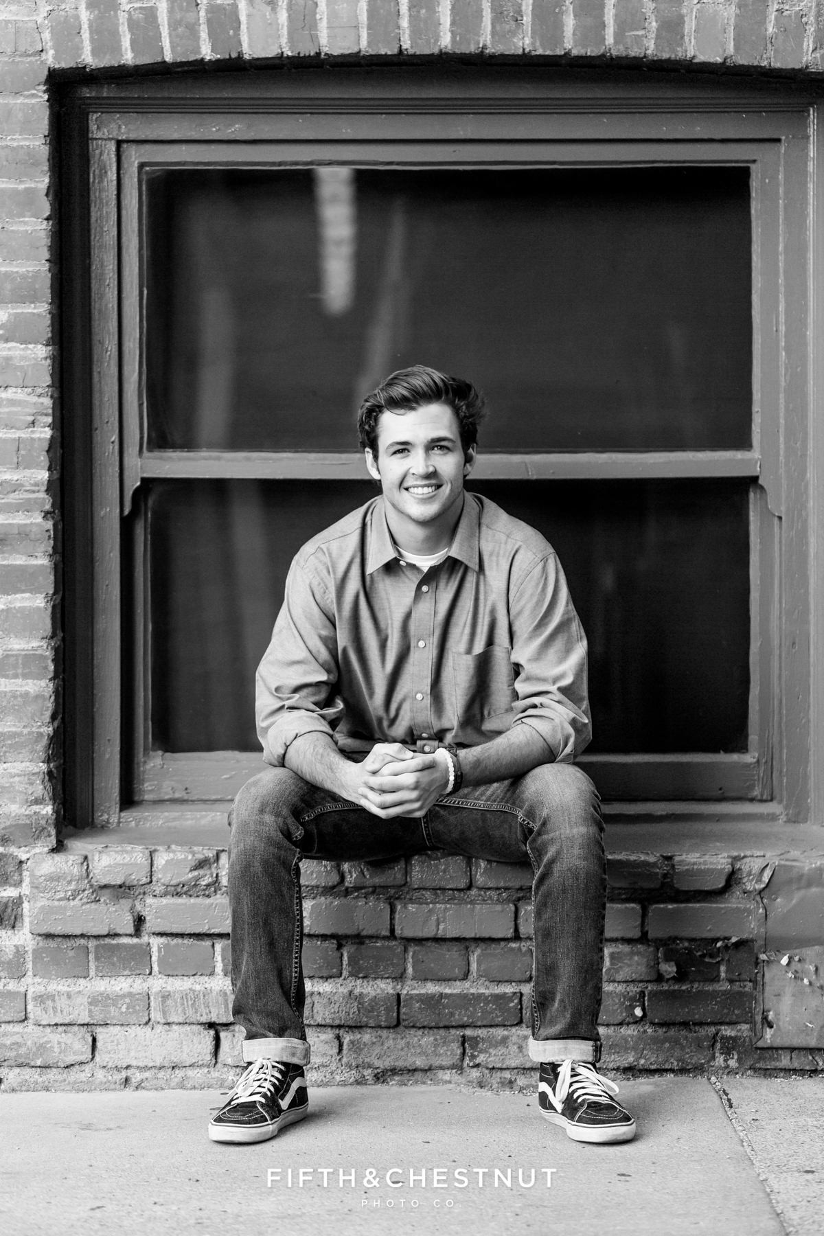 Black an white Reno senior portrait of Reno High School Senior Tim H wearing a blue shirt in the Downtown Reno area