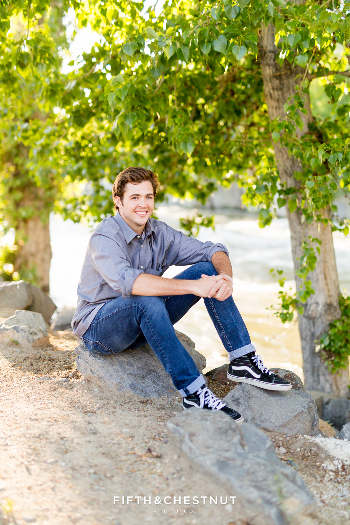 Reno High School Senior posing by the Truckee river for his Reno Senior Portraits by Reno Senior Photographer
