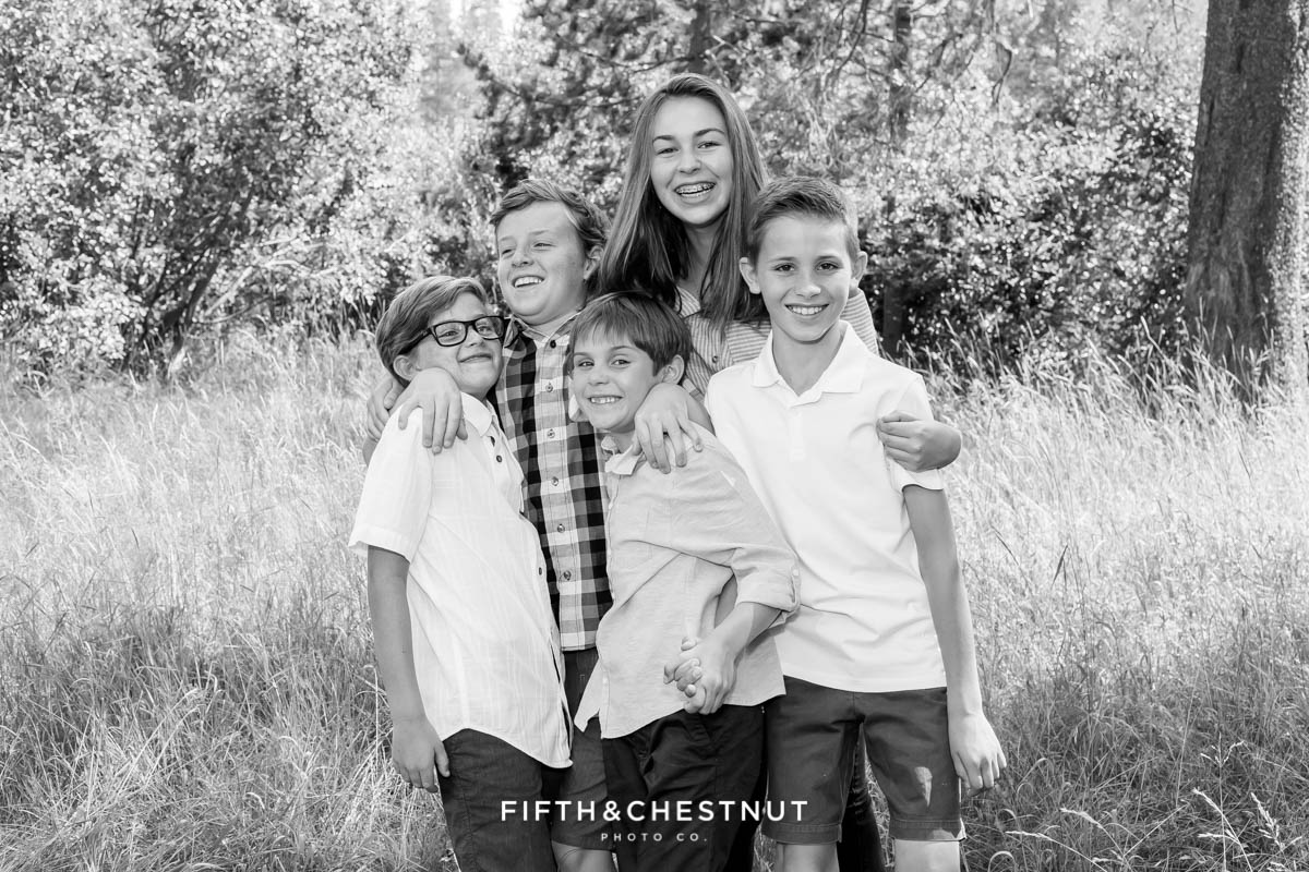 grandchildren acting silly for tahoe donner reunion portraits in Truckee, CA