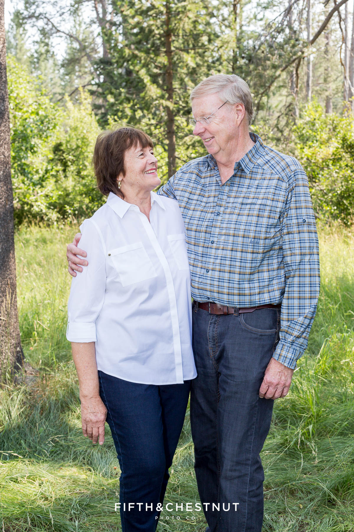 grandparents smile at one another for truckee family portraits in tahoe donner area