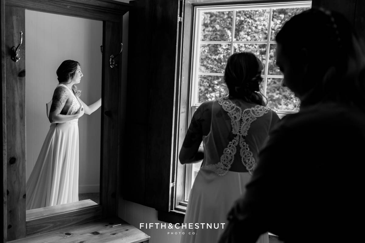 Bride anxiously awaits her Twenty Mile House wedding ceremony to be married
