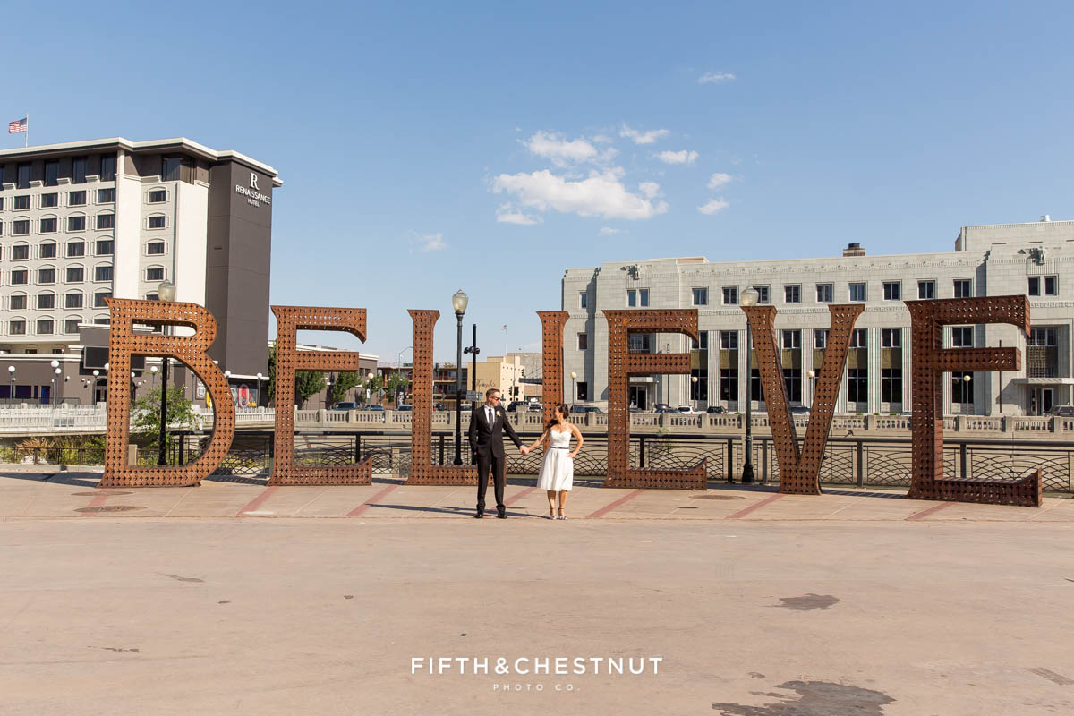Bride and Groom in front of the Believe installation in downtown Reno before their Downtown Reno Elopement