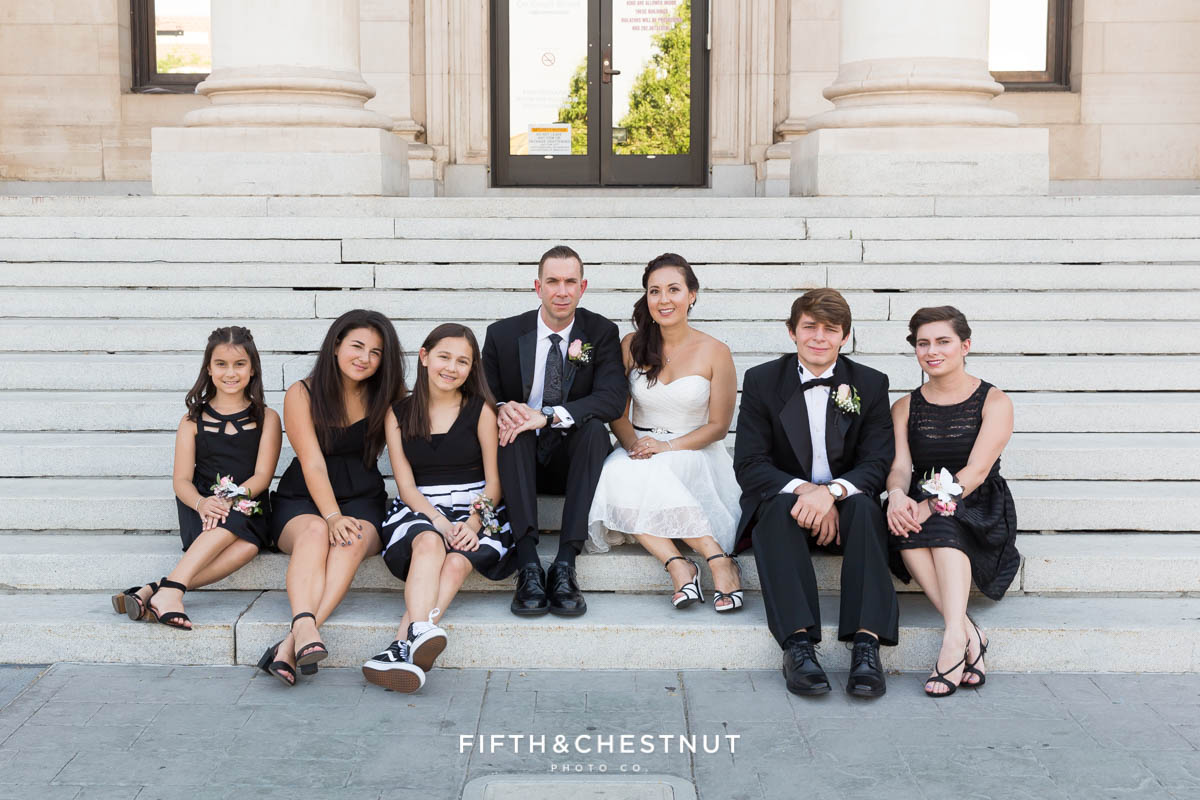 Family on the courthouse steps before a Downtown Reno Elopement