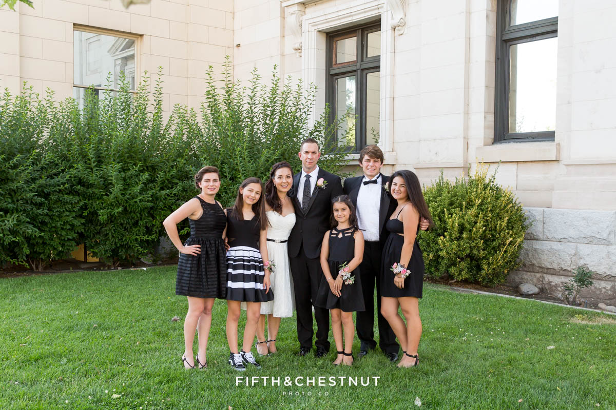 Family portrait during a Downtown Reno Elopement in front of the old Reno courthouse
