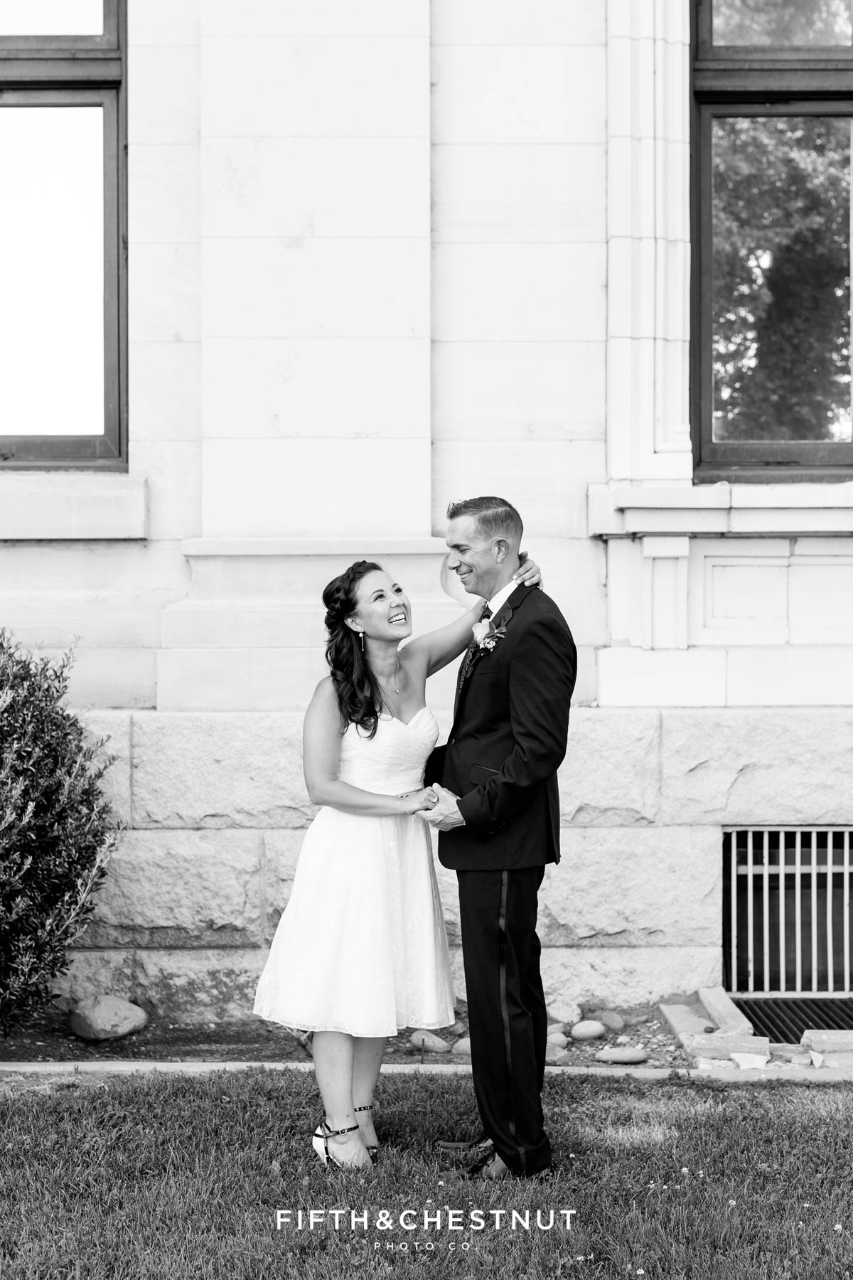 Black and white image of bride and groom laughing by Reno Wedding Photographer