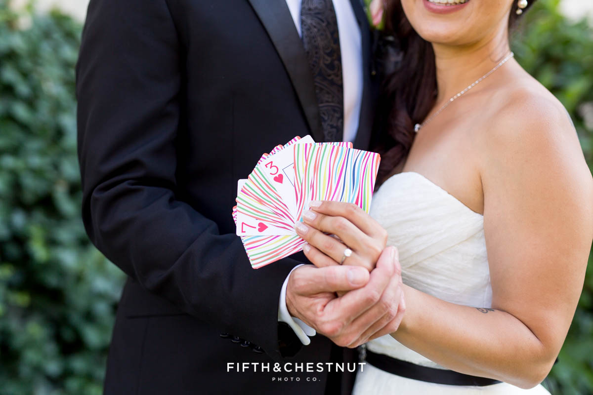 Bride and groom hold playing cards that display their wedding date in Reno