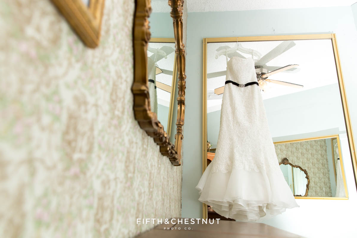 Wedding gown hanging from a closet in the Antique Angel Wedding Chapel in Reno before a Downtown Reno Elopement