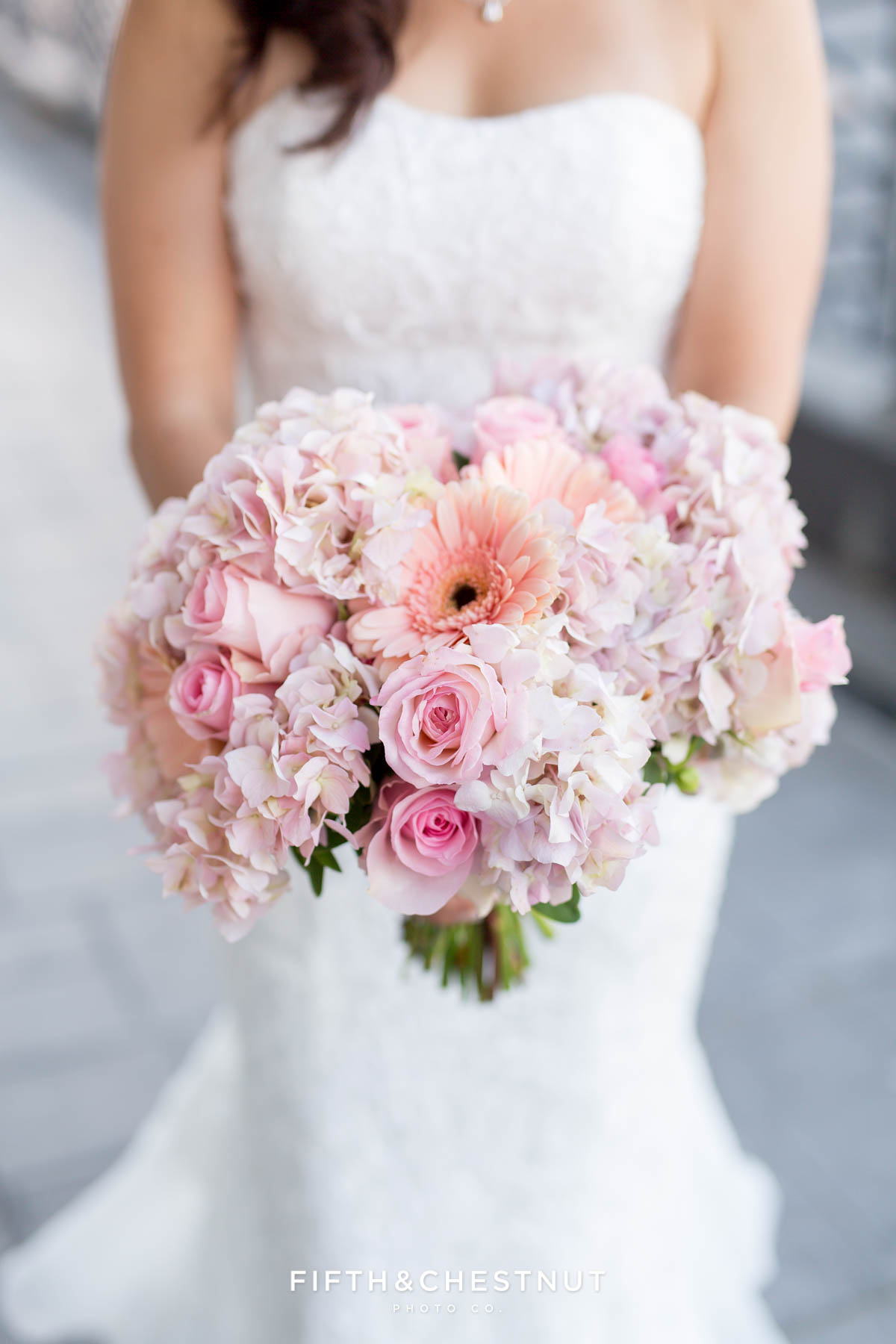 A Downtown Reno Elopement wedding bouquet made of hydrangeas, roses and pink gerber daisies