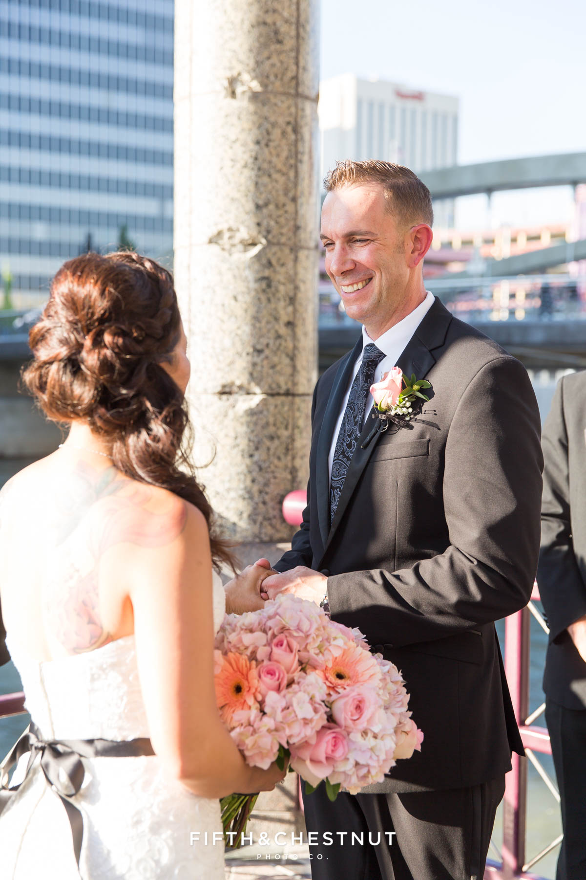 Groom smiles during Downtown Reno Elopement ceremony on the river