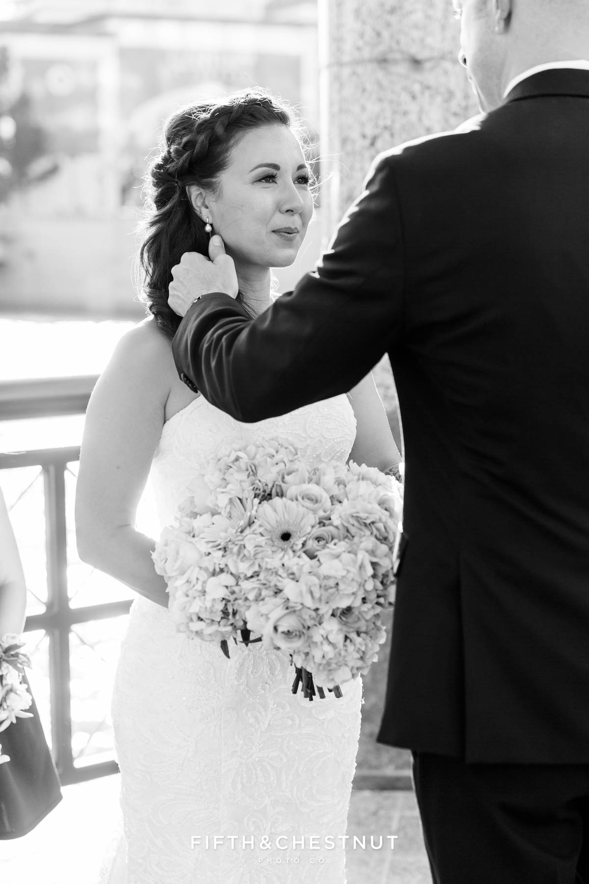 Groom wipes tears from Bride's eyes as she cries during her Downtown Reno Elopement ceremony on the river
