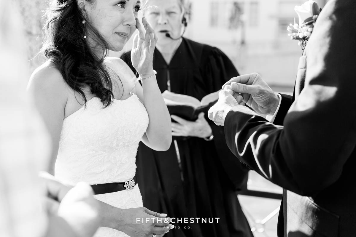 groom cries as groom is about to put on her wedding ring