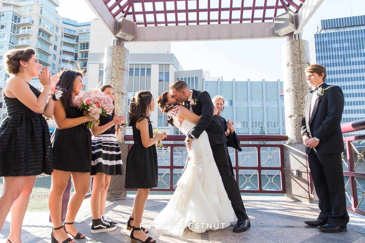 Groom dipping bride during ceremony kiss