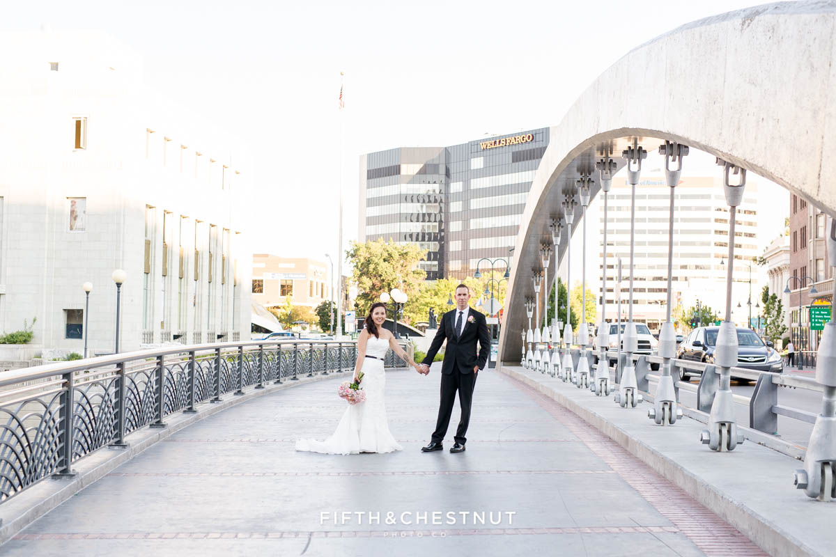 Bride and groom stand on the virginia street bridge after their Downtown Reno Elopement
