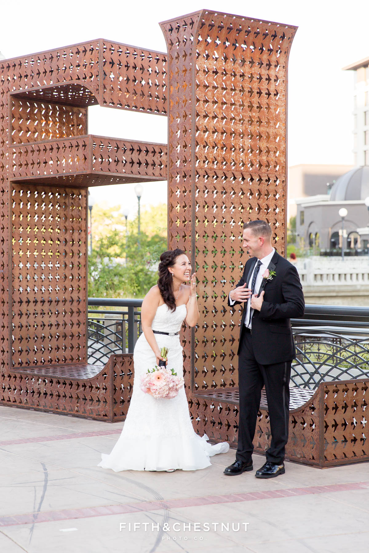 bride laughs while groom jokes at the believe installation in downtown reno