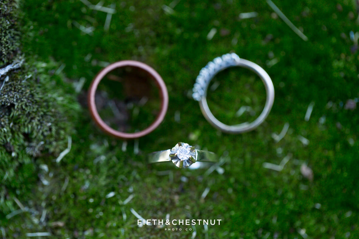 Closeup of wedding rings on moss for a North Lake Tahoe Wedding by Lake Tahoe Wedding Photographer