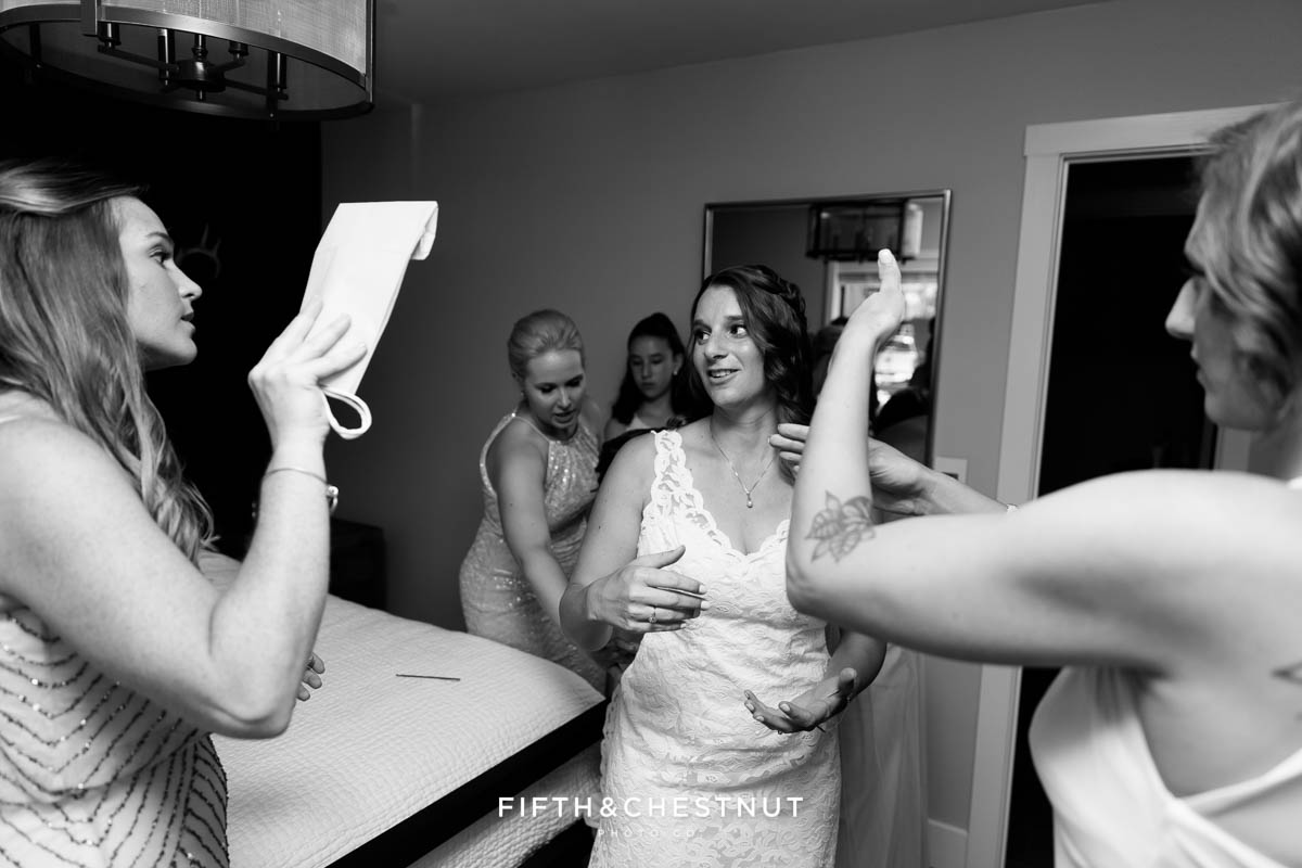 Bride shows emotion while her and her friends get ready for a North Lake Tahoe Wedding by Lake Tahoe Wedding Photographer