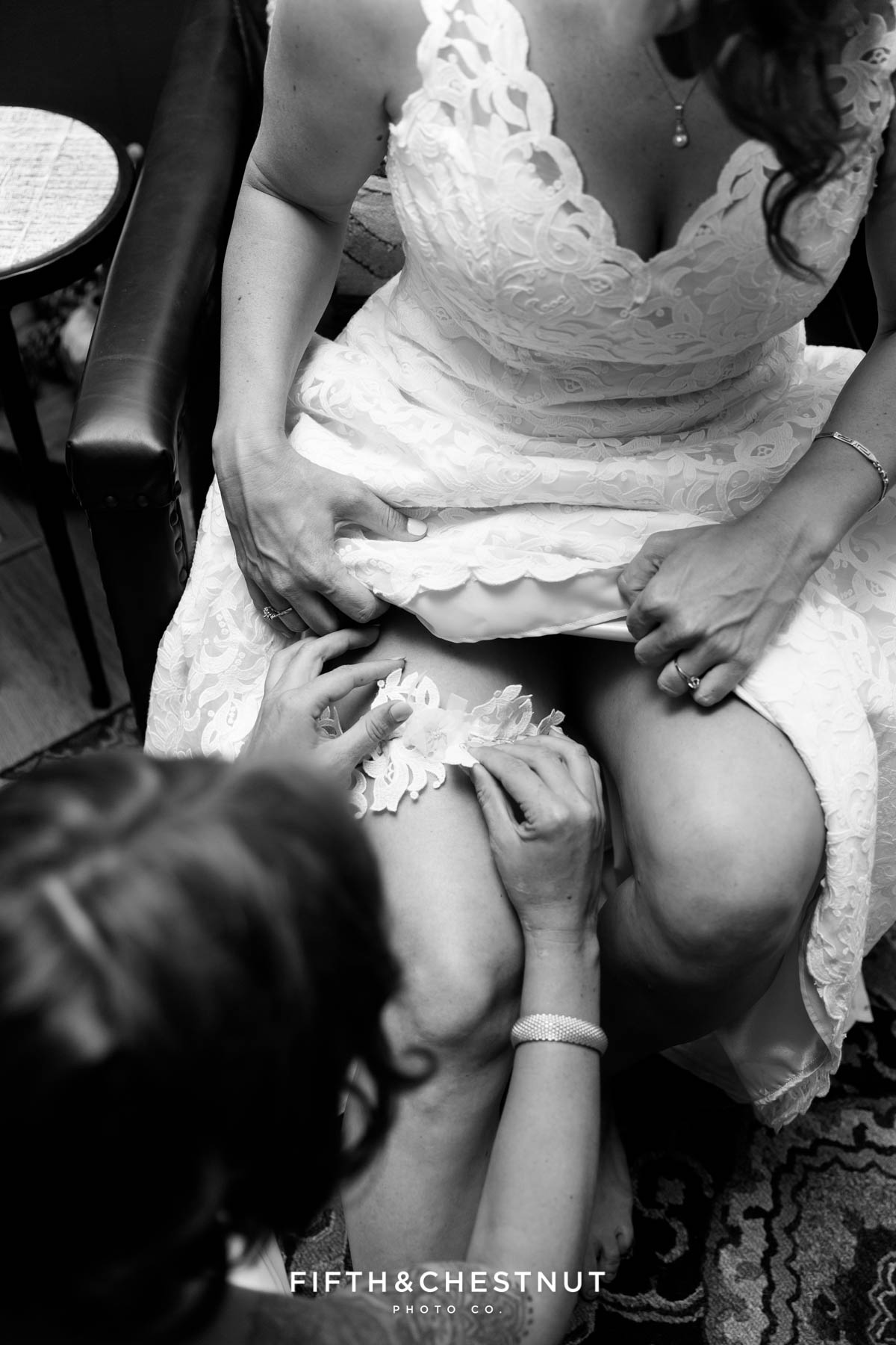 Bride's sister puts her garter on before the first look of a North Lake Tahoe Wedding by Lake Tahoe Wedding Photographer
