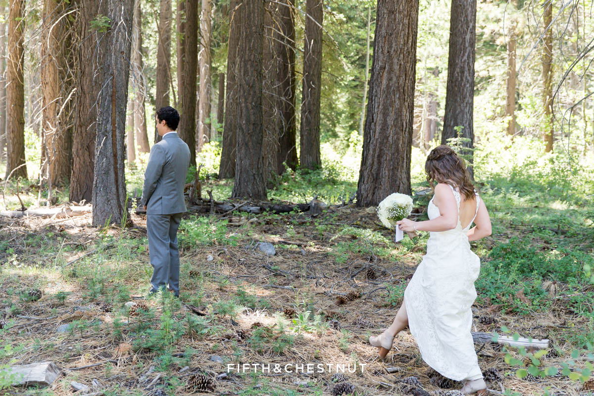 Bride walks up to her groom in the forest on the west shore for a first look before their north tahoe wedding