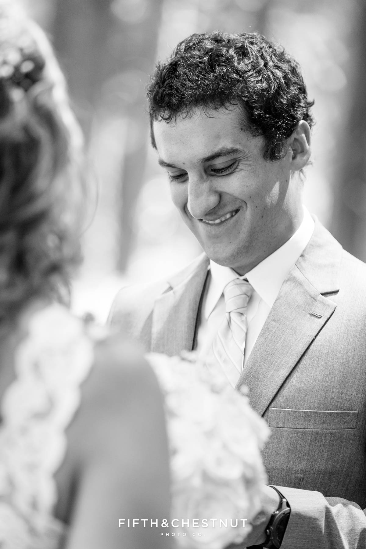 Groom reads a handwritten note from his Bride after their first look before their North Lake Tahoe Wedding