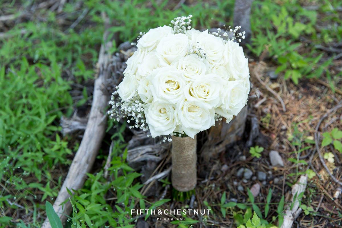 Closeup of rose wedding bouquet before a Tahoe wedding