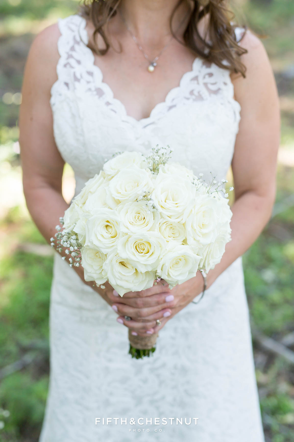 Bride holding wedding bouquet of roses before her North Lake Tahoe Wedding