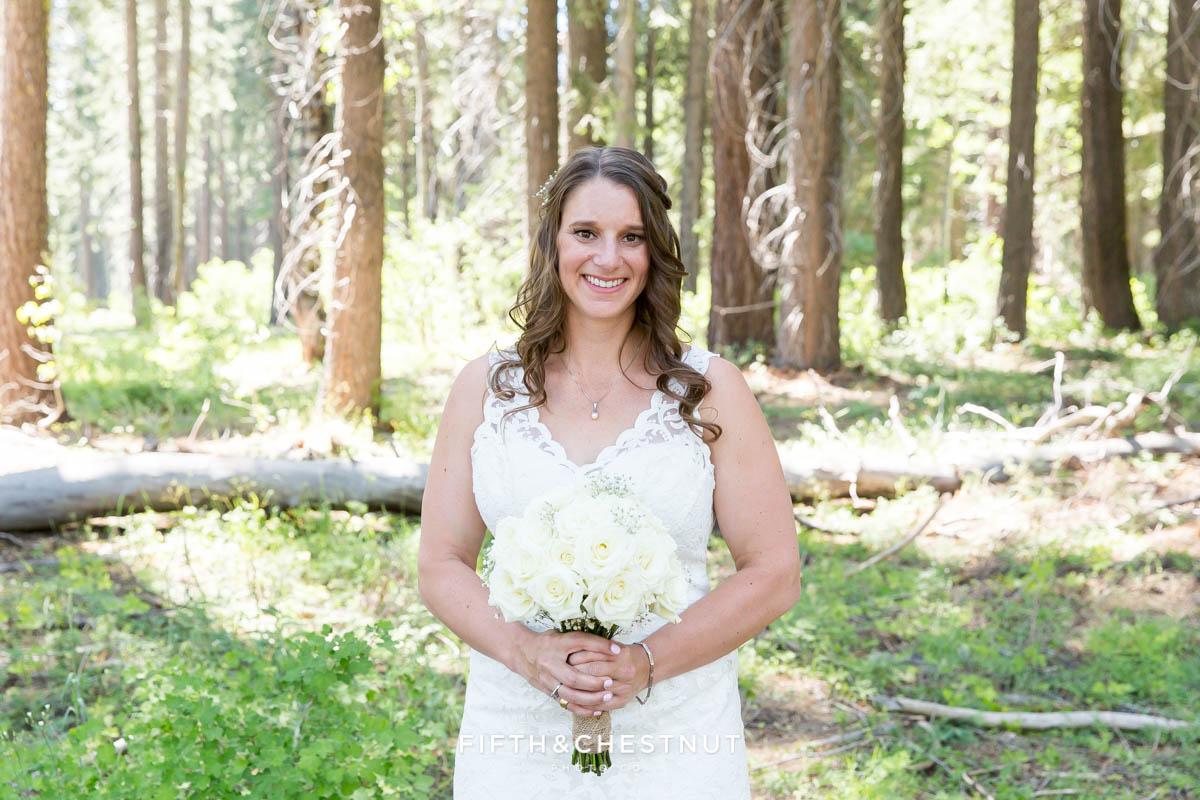 Bride holds rose wedding bouquet in her custom Ecuadorian wedding gown before her North Lake Tahoe Wedding